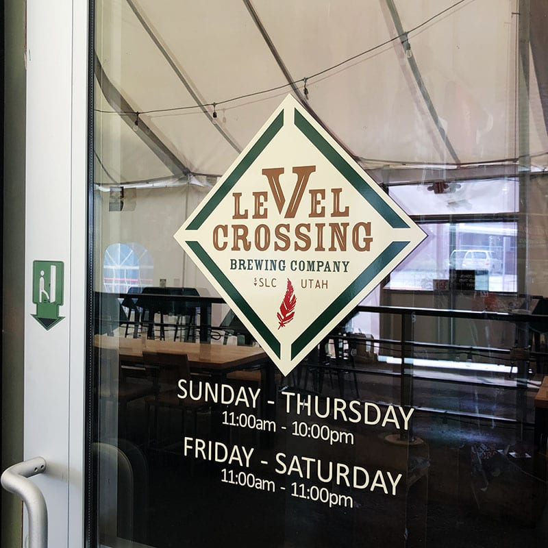 The Level Crossing Brewing logo and hours in 2021.