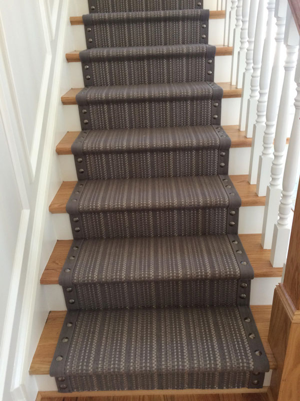 grey stripes on carpet with rivets by Farsh Carpets