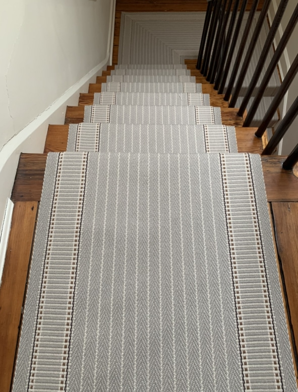 Grey Striped Carpeted Stair Runner Top and Landing Installed by Farsh Carpets & Rugs