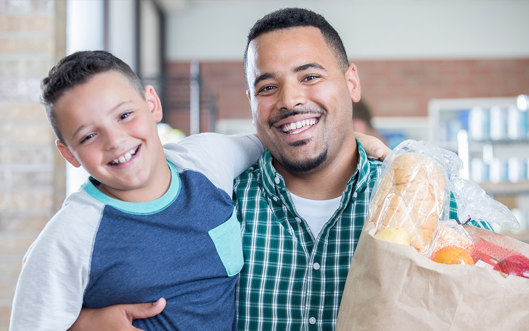 Father and son - get food from ECHO food bank
