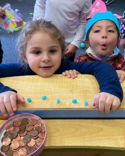 Preschooler learning about money