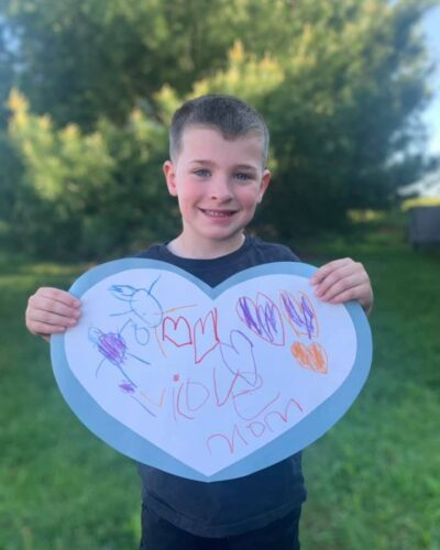 Preschooler with Mother's day Craft Project