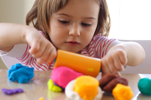 child playing with play dough 2
