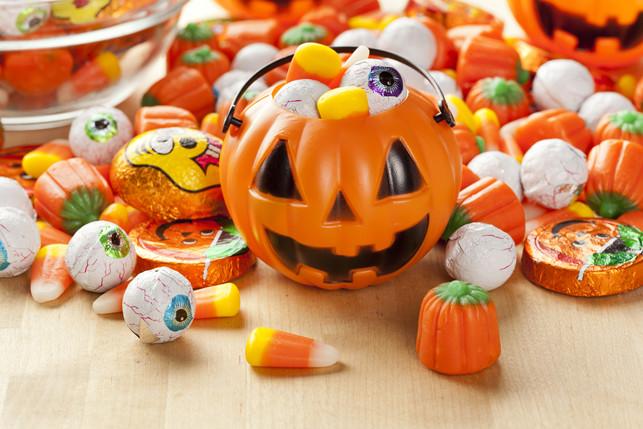 halloween candy in a small pumpkin bucket 4