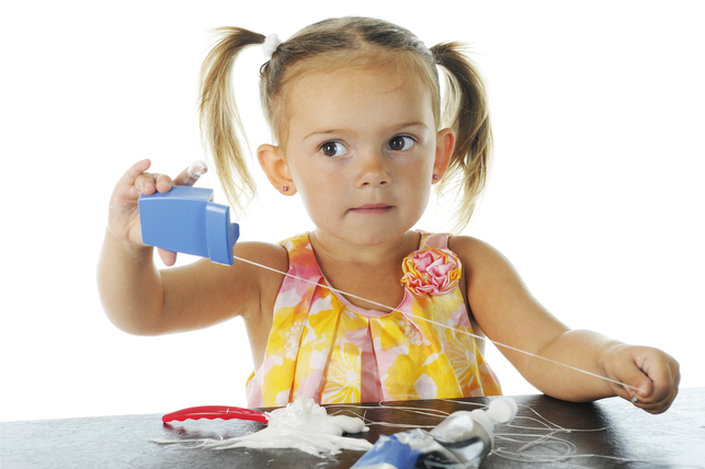 child playing with dental floss 2
