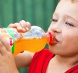 child drinking orange soda 4