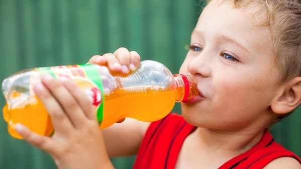 child drinking orange soda 3