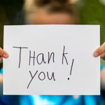 child holding a thank you sign 4