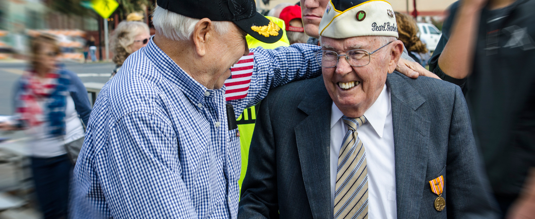 photo of two senior World War II veterans greeting each other