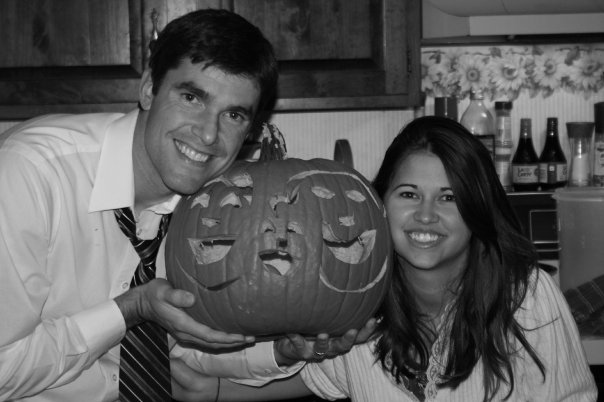 Joey and Maegan carve a pumpkin with three faces to announce their pregnancy that fall.