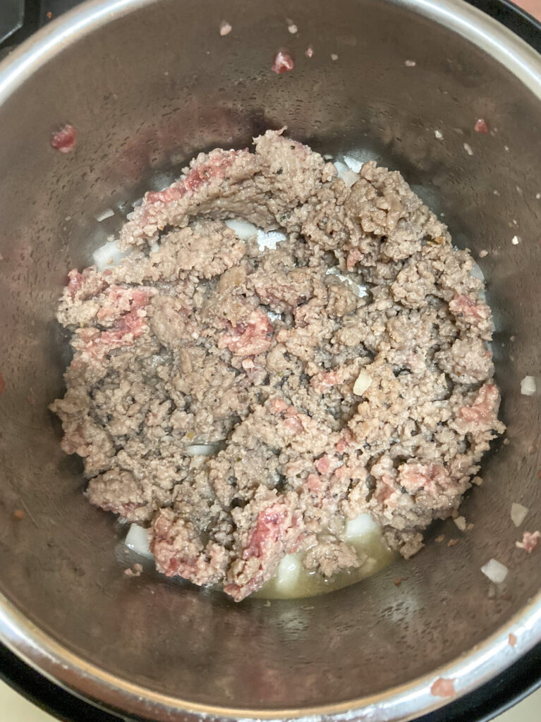 Instant Pot full of browning sausage