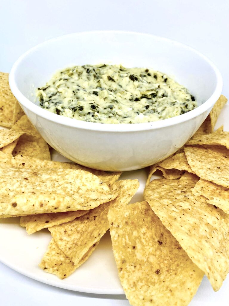 Instant Pot Spinach Artichoke Dip in a Bowl with tortilla chips