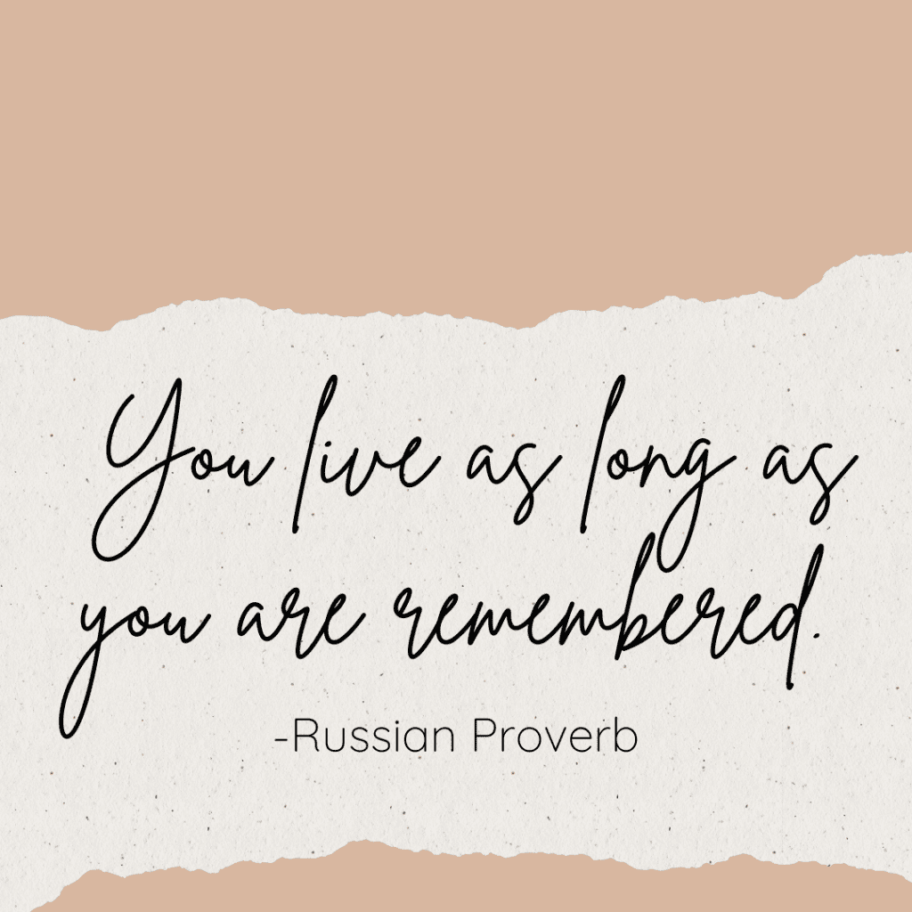 Parchment with quote You live as long as you are remembered. -Russian Proverb