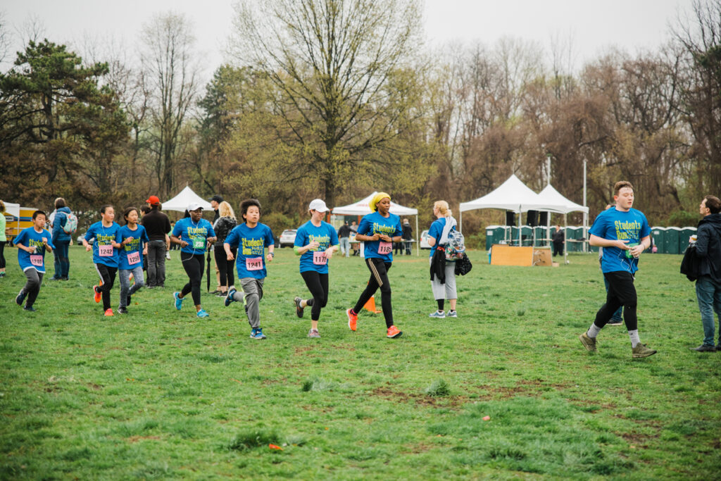 Students race towards the finish line. Photo by Heather McBride.