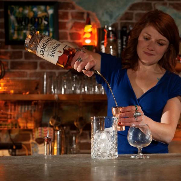 Gingi at Bar making cocktail