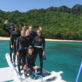 Guests waving to the camera as they prepare in their Diving gear for a dive in Linapacan, Palawan