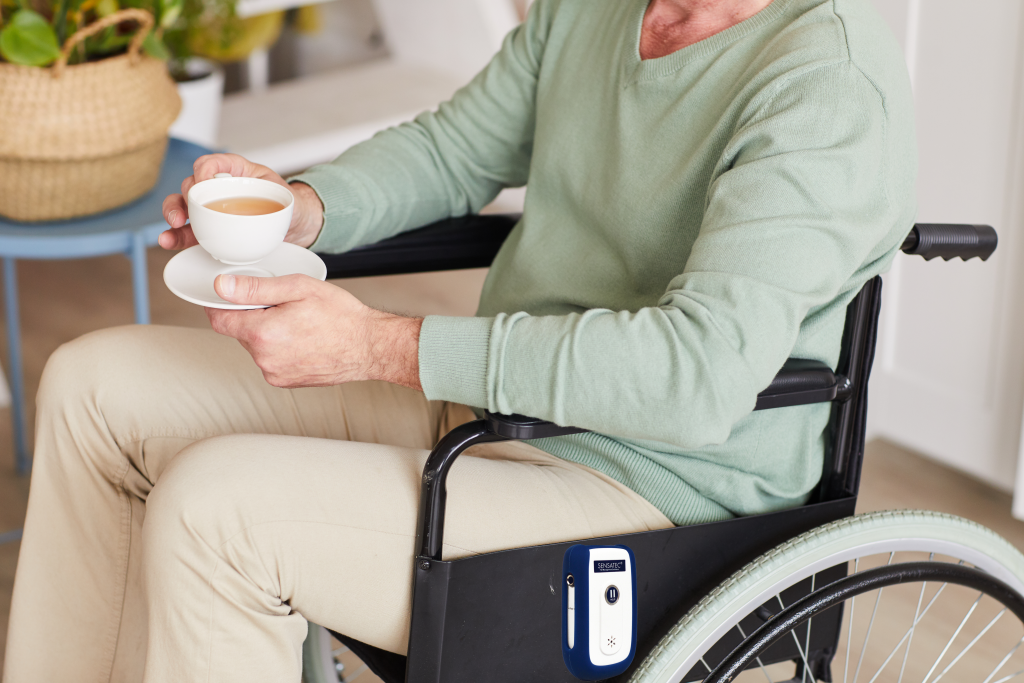 close-up-disabled-man-sitting-wheelchair-with-cup-tea-home