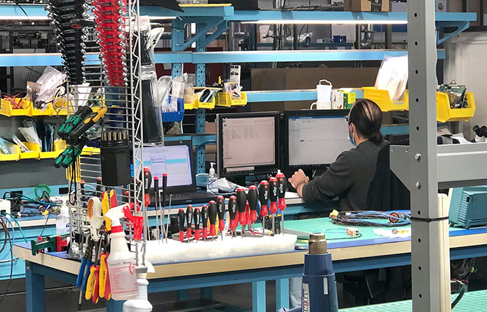 Engineer working on computer in workshop