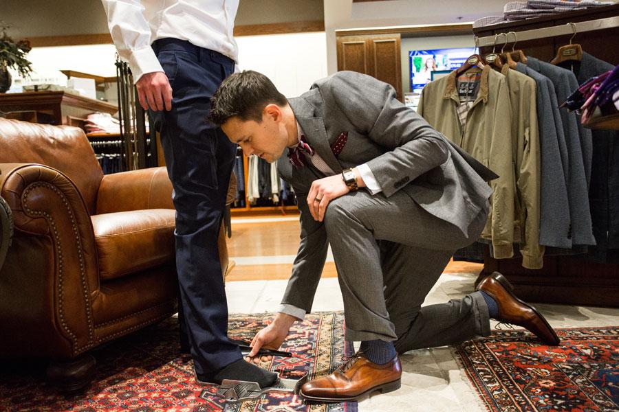 Men measuring shoes size
