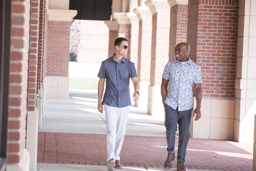Two men walking on the street