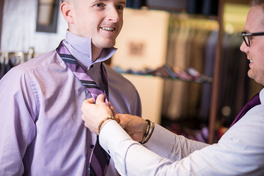 Helping a men to put on a tie
