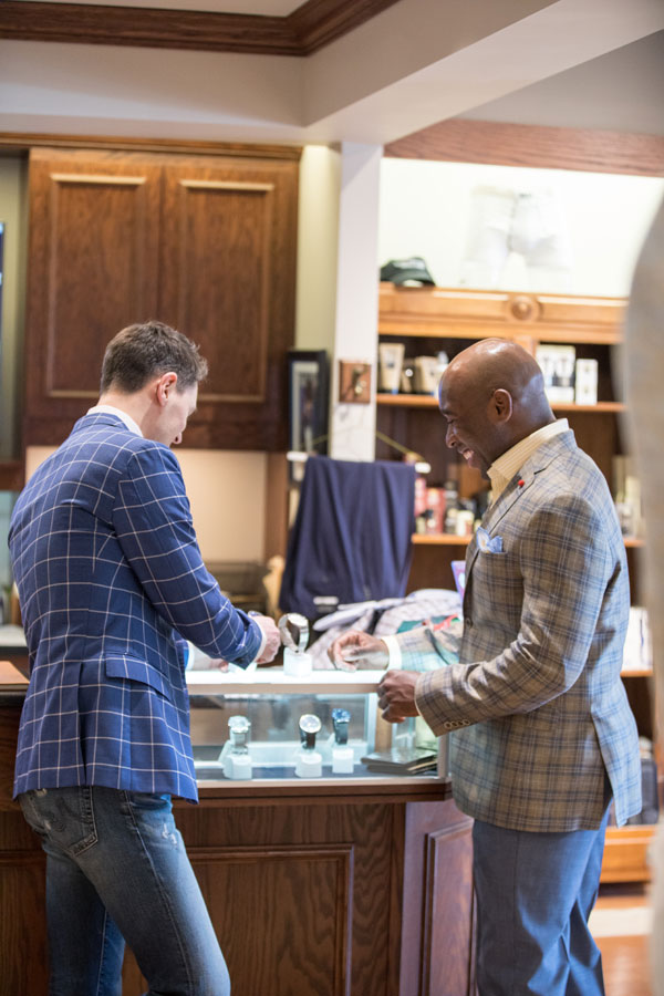 Furnishings & Accessories - two men looking at a watch
