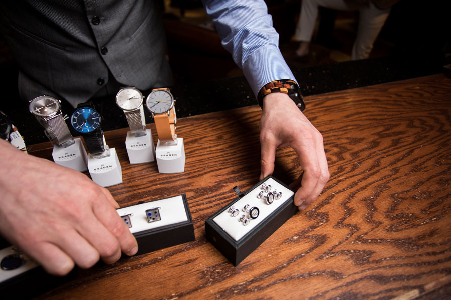 Furnishings & Accessories - men placing cufflinks on the table