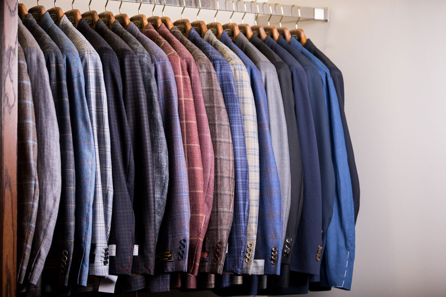 Tailored and Custom - suits hanging