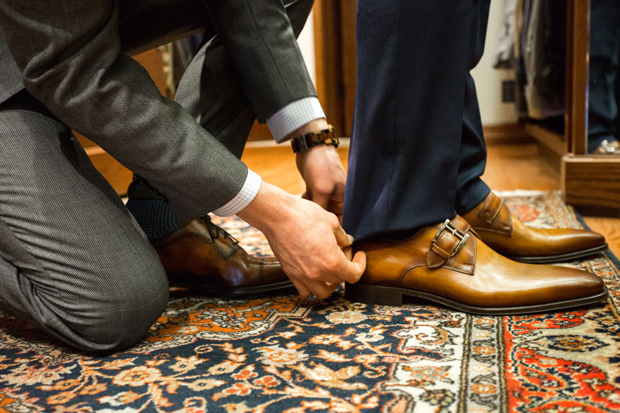 Shoes & Belts - man trying on shoes
