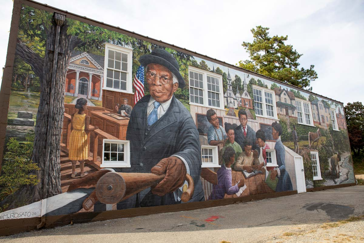 Side of TC Walker mural on building in downtown Gloucester