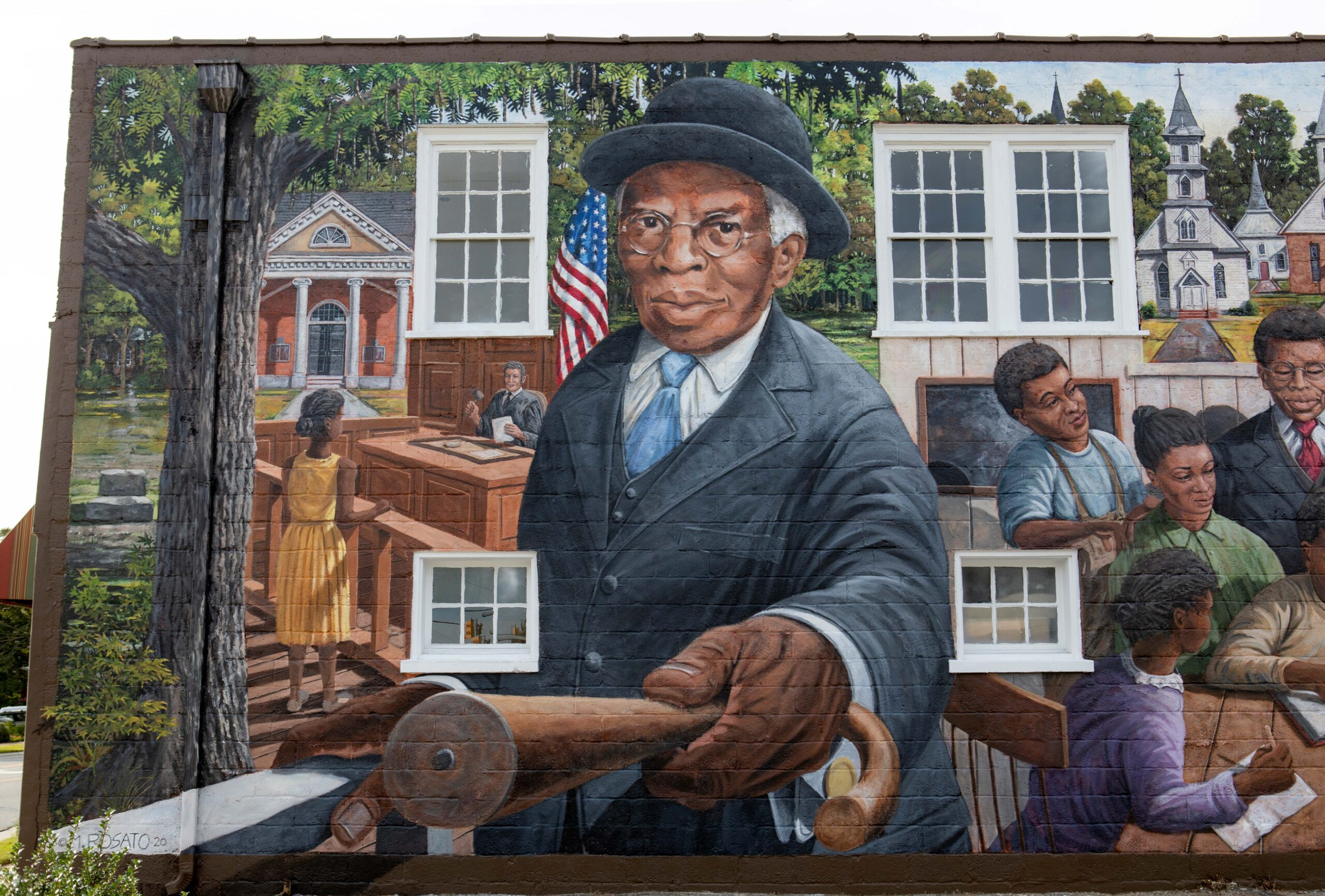 Detail of TC Walker mural on building in downtown Gloucester