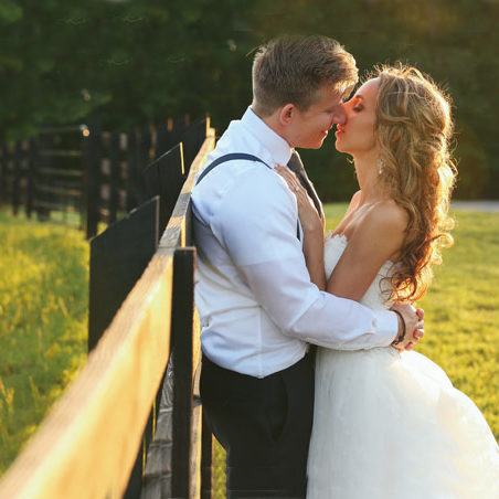 Event & Wedding Venue Couple Leaning Against Barn Fence