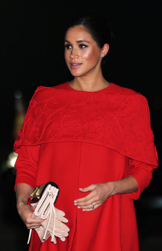Meghan Markle in Red Valentino Cape Dress for her arrival in Morocco with Prince Harry