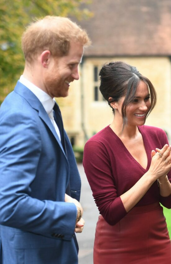 Duchess of Sussex in Red Pencil Skirt for Roundtable Discussion at Windsor Castle