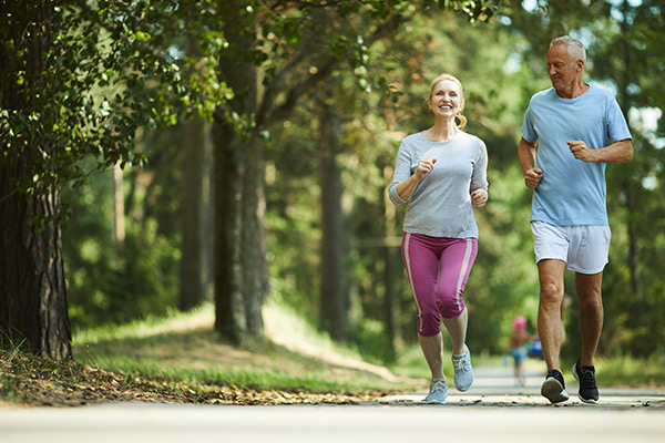 Couple jogging with pain-free knees
