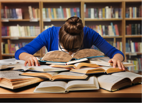 A woman sleeps on a pile of books and is overwhelmed with school. Womens drug treatment programs are warning against abusing the drug known as Adderall.