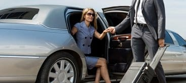 Chauffeur providing Calgary Airport Limo Service
