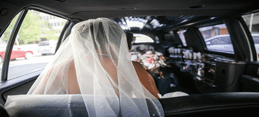 Calgary Wedding Limousine Service from Signature Limos with bride in Limo