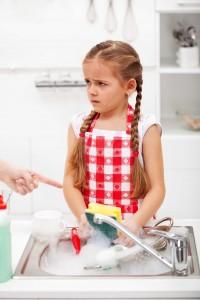 unhappy child doing chores
