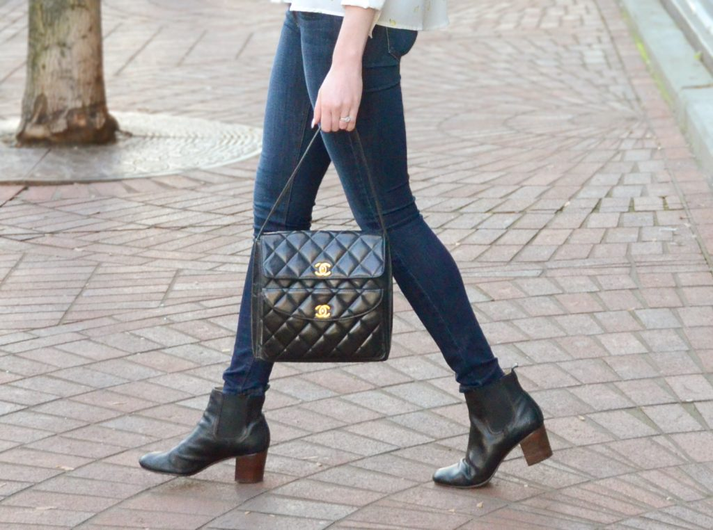 Vintage Chanel black quilted handbag, Just Black blue jeans, Des Petits Haut lemon blouse, Frye Stella Chelsea Short boots