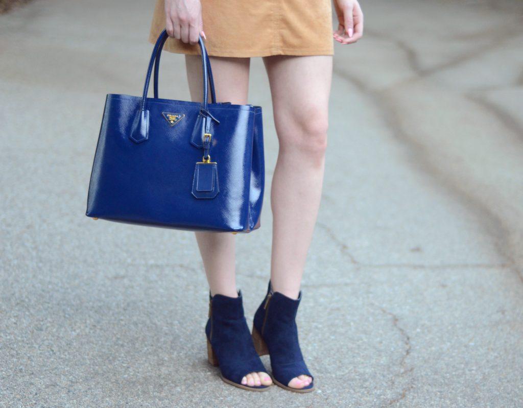 be-bop faux suede shift dress. mari a navy axle peep toe booties, prada navy blue tote bag