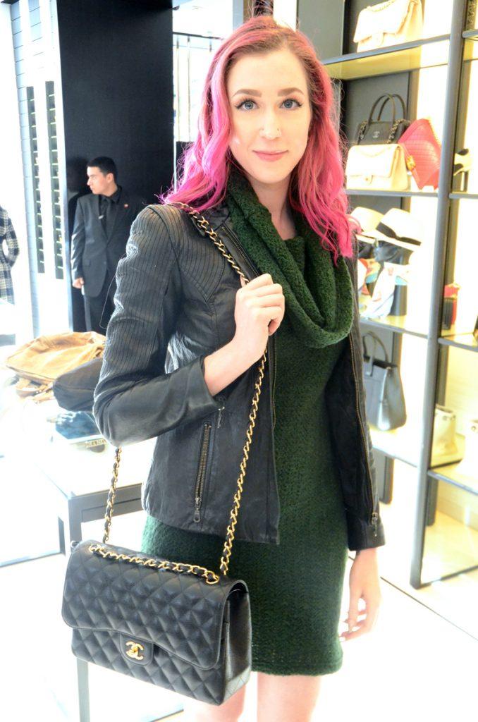 Chanel Jumbo Classic Flap black caviar, green sleeveless sweater dress, DKNY black leather jacket