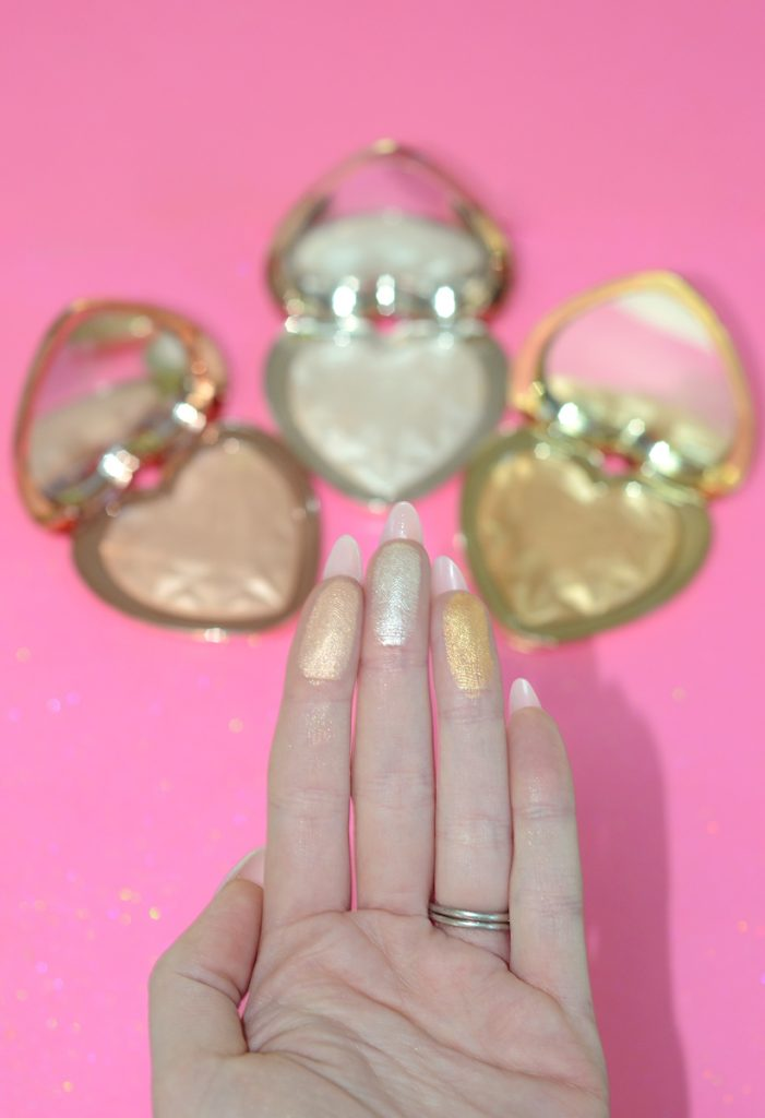 Los Angeles Cruelty-Free Beauty Blogger, Emily Wolf Beauty shares a review with swatches of the Too Faced Love Light Prismatic Highlighters.