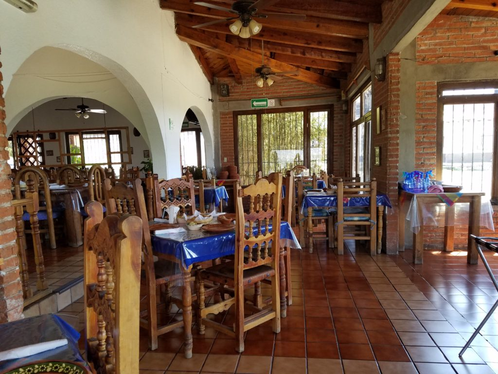 Inside La Casa de Mole- traditional brick walls and wooden tables