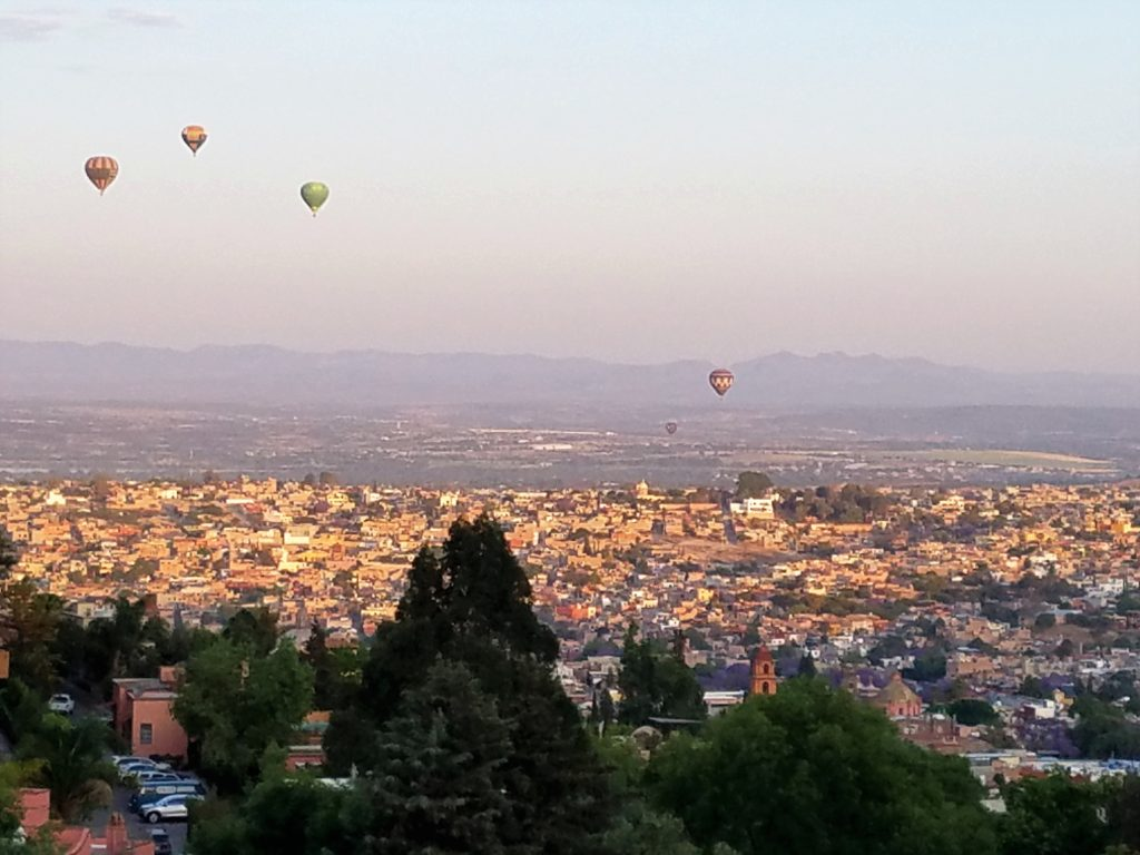 Hot air balloons at sunrise over San Miguel de Allende