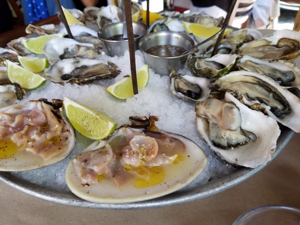 Fuente Royal seafood tower bottom layer with oysters and clams at La Docena Oyster Bar & Grill in Guadalajara, Mexico