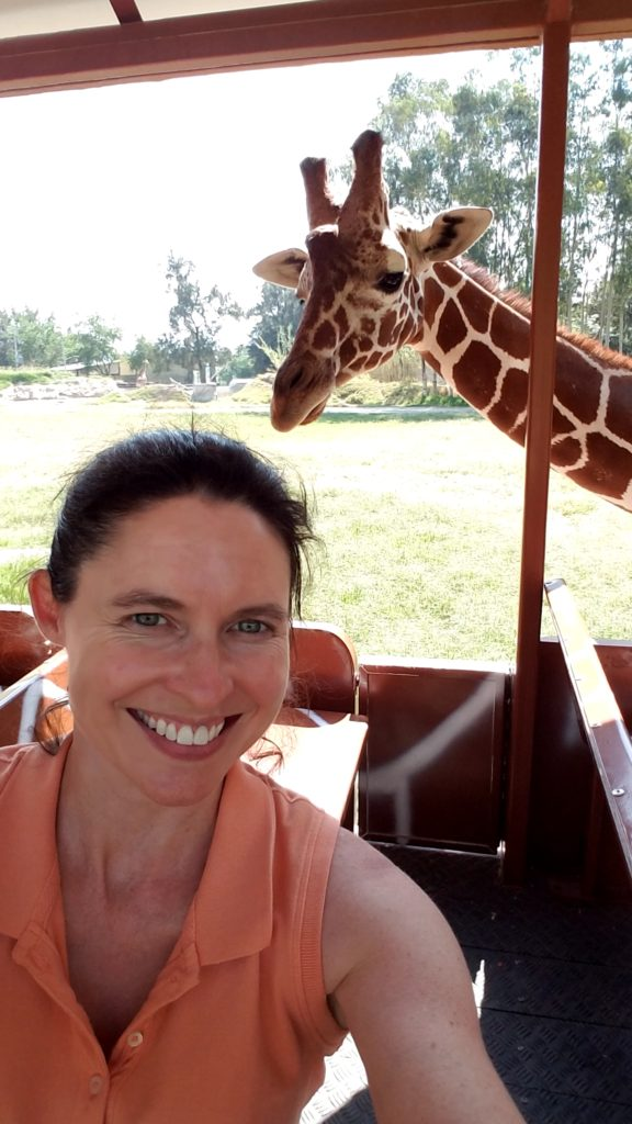 Tiffany with a giraffe at the Guadalajara Zoo