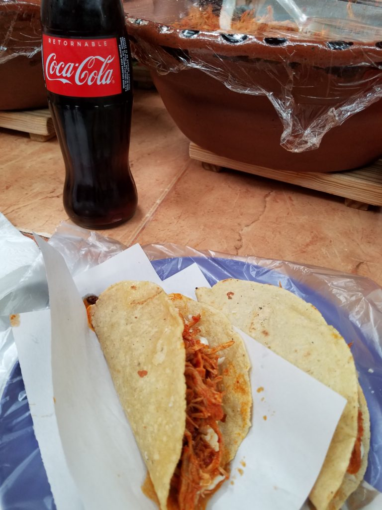 2 quesadillas with chicken tinga and a real bottle of Coca-cola at Mercado La Cruz