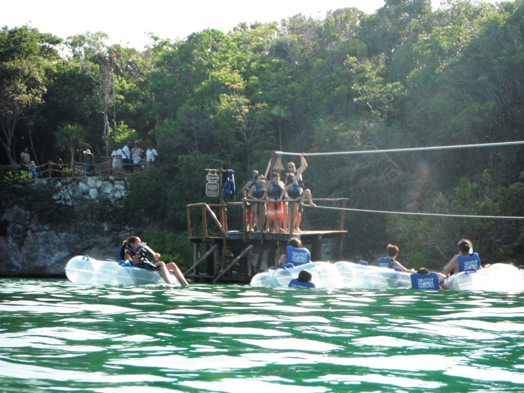 People floating and rope climbing Xel-Ha, Mexico