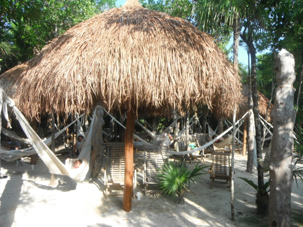 Hammocks under a palapa at Xel-Ha, Mexico